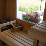 zicht vanuit de sauna op de weide wereld wellness bij buitengoed de gaard alleen voor gasten vakantiehuisje en pipowagen