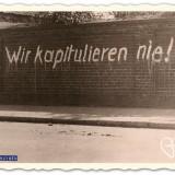 wir kapitulieren nie-leuzen op muur in heythuysen foto uit boek verdraagtj uch- archief hugo levels